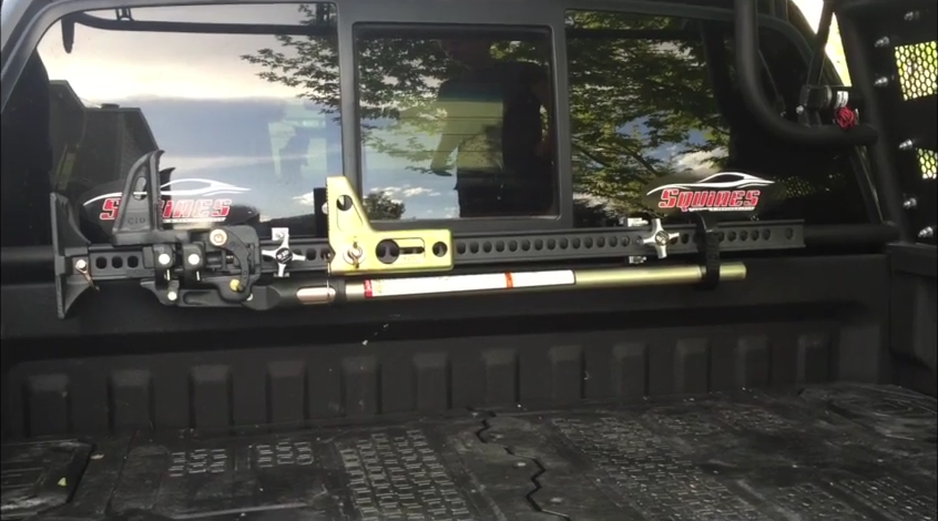 Hi-Lift Jack mounted in Ford Raptor and Addictive Desert Designs Chase rack.
