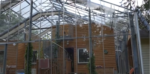 This Swedish family built a Greenhouse around their home.